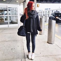 Pin for Later: 22 Easy-to-Copy Looks That Will Help Take Your Travel Style to New Heights An Oversize Sweater, Jeggings, Sneakers, and a Scarf