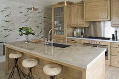 Limed oak kitchen cabinets may also be called cerused or pickled. The finish updates oak kitchen cabinets so they blend well with marbles and metals.