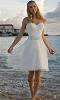 short wedding dress. Really cute and u would be able to see me boots!!!!!