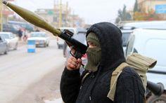 A Shiite gunman hold