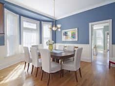 Traditional Dining Room with Hardwood floors, Heritage Lace Milady Single Curtain Panel, Chandelier, Bay window Blue Dining Room Paint, Dining Room Colors, Dining Rooms, Blue Rooms, Blue Walls, Living Room White, Home Goods Decor, White Paneling, White Decor