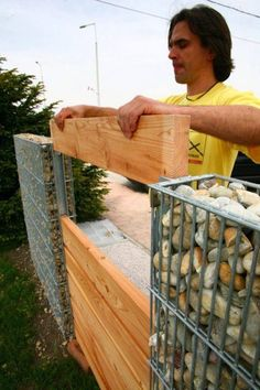 How it's made; wood slots in between gabion walls.