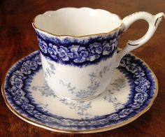 This gorgeous demitasse set is by Coalport of England. It is in the pattern Dalemere and in cobalt blue on white. There is a band of blue flowers