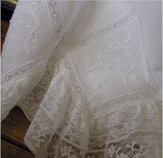 Exquisite heirloom christening gown using french laces and hand embroidered shadow work