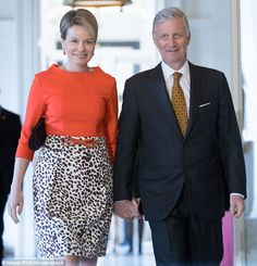 Affectionate: The Belgian king and queen were seen walking through the palace hand-in-hand