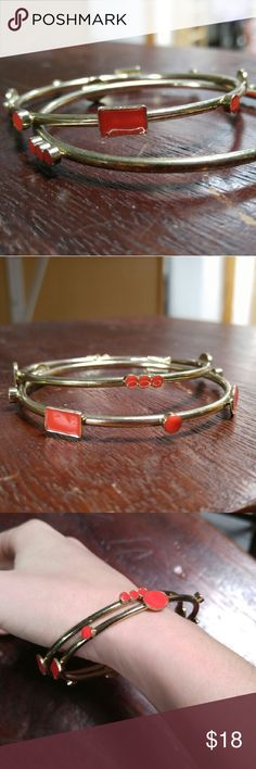 Set of 2 Vintage Red and Gold Bangle Bracelets VTG red and gold bangle bracelets in excellent vintage condition! Set of two skinny metal bracelets with various red geometric shapes on gold colored bangles. No trades. Make a reasonable offer. Thanks! Vintage Jewelry Bracelets