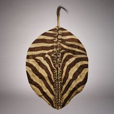 View this item and discover similar for sale at - A magnificent quagga hide shield. This spectacular shield is one of the rarest known African shields in existence. The quagga (Equus quagga quagga) is Tribal African, African Art, Cultural Artifact, Arm Armor, African Jewelry, Tribal Art, Ethiopia, Art And Architecture, Archaeology
