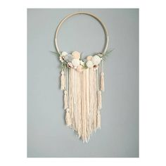 Wall Hanging - Custom To Order Make your wall beautiful with this soft and boho dreamcatcher! Perfect for any room! The base is a natural wood hoop made of artificial flowers and pom poms. The extensions are a variety of cream ribbon, off white wool and lace. Size guide: