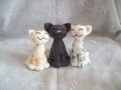 Happy Needle felt Cats  .. I don't need another craft to do but these are adorable.. glad I am allergic to wool