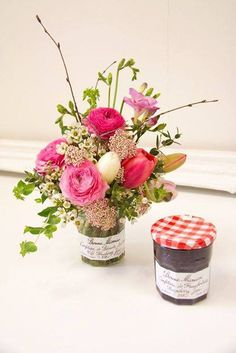 Use jelly jars for vases ... perfect ... low so table guests can see one another!