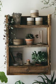 Bohemian living, filling a home with rustic and natural details, shelves made from pallet wood, handmade ceramics, plants, where nature and love collide.