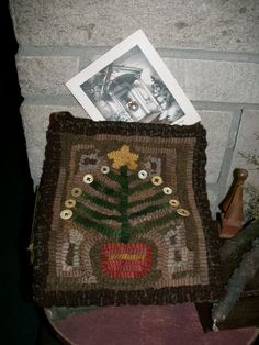 This is a hooked rug feather tree w/antique buttons pocket I made..great to use a holder for Christmas cards, etc...