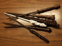 Diy Harry Potter style wands made from hot glue, chopsticks, acrylic paint, and odds n ends.