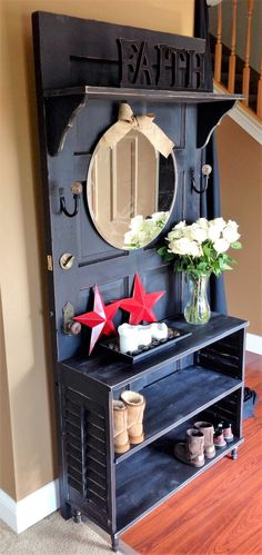 This piece will be perfect to be placed besides your front door. This old wooden door has been re-purposed beautifully into a show rack and a coat hanger. A mirror has been attached for added value. The color of the wood is warm and traditional. You may add any personal decorative touch as per your desire.