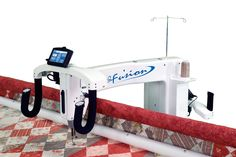 HQ24 Fusion. I would love to have the extra space that this machine has.  I have the HQ16 and it is a great running machine.  My quilting is growing and I need a machine to grow with me along with the pro-stitcher :)