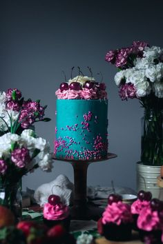 Luxury white chocolate layer cake with cherry swiss meringue buttercream recipe - food photography