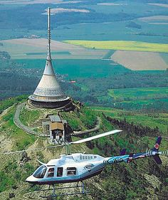 Jested Tower is a 94-metre-tall tower used to transmit television signal built on the top of Jested mountain near Liberec in the Czech Republic.  Jested Tower is a reinforced concrete construction with a shape called hyperboloid, built between 1963 and 1968.  The tower's architect was Karel Hubacek.  In the tower's lowest sections it contains a hotel and a tower restaurant.  Photo: google.com Reinforced Concrete, Mediterranean Sea, Black Sea, Atlantic Ocean, Czech Republic, Sailing Ships, Tower, Europe, Construction