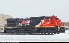 RailPictures.Net Photo: CN 2128 Canadian National Railway GE C40-8 (Dash 8-40C) at Madison, Illinois by Mike Mautner