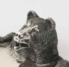 A Fabergé silver tray, St. Petersburg, 1899-1904 realistically cast and chased as a bear skin, with red cabochon hardstone eyes, struck with Cyrillic initials K.F. and 84 standard