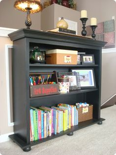 What a thrifty way to make a hutch look like a bookshelf. I have a hutch just waiting for this very solution.