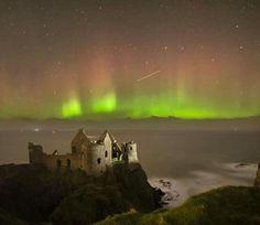 Aurora Northern lights over Dunluce Castle, Co Antrim, Ireland.