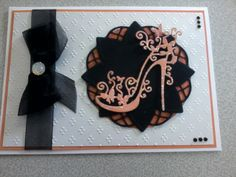Card made using embossing folder and tattered lace shoe