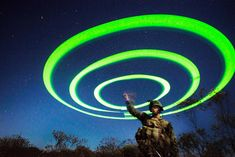 Marine using a string of chem lights to signal a landing zone