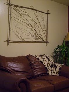 Branch art: Pick some branches in the woods and have a nice frame for you living room -