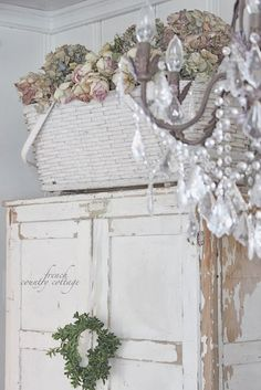 Another view of that really cute baby basket with dried flowers ~ FRENCH COUNTRY COTTAGE: Vintage Basket