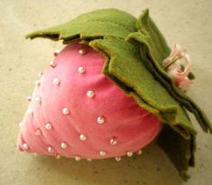 Pink velvet strawberry pincushion with tiny pearl seed beads.