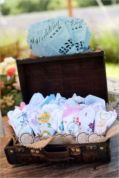 suitcase filled with hankies :: Lc- such a cuuuuute idea - very affordable if you make your own. An excellent favor, especially during an emotional ceremony.  Or a ceremony/reception in hot weather!