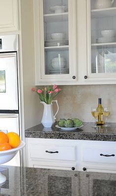 Adding glass to your kitchen cabinet doors, diy. Would look nice frosted, as well.