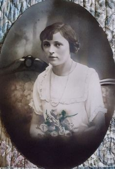 """Beautiful hand tinted photograph of a young woman sitting on a sofa with a rose bouquet. This is oval and measures 19 3/4"""" x 13 3/4"""". This was in a bubble frame so it is somewhat concave. No frame is included. On the back is some handwriting with the tinting specs. Dated 4-28-24. Please look at all of the pictures as they are part of the item description. Any questions, please ask. No returns. Thanks for looking. 
