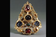 Hair ornament with gemstones<br>  Buried 1517; Zhengde period (1506-1521)<br>  From the tomb of Duchess Xu at Bancang, outside the Taiping Gate<br>  Nanjing; gold with repoussé design and gemstone inlay<br>  3 1/4 x 2 1/2 x 3/4 inches