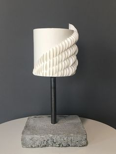 We're obsessed with this ultra-modern number. The wraparound sugar suggests the cake could fly away at any moment' if only the industrial concrete stand weren't anchoring it down. The Butter End Cakery LA