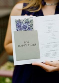 Tissue in wedding program for happy tears. How sweet.