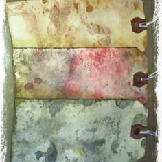 Tags made with Tim Holtz Distress inks. Rubbed ink onto craft mat. Spray water on ink with mister. When ink bubbles, blot tag into ink. Dry with heat gun. Repeat inking and dry again.