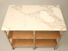 Stainless Steel and Bronze Kitchen Island with Calcatta Marble Top - bet you could make your own for less than $9500