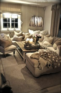 more pillows and throws than you know what to do with for Rainy Sundays...I LOVE throws!