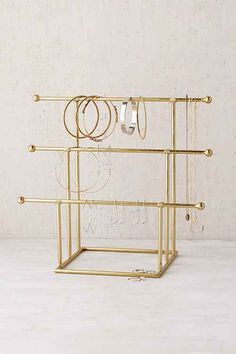 Shop jewelry stands, boxes and necklace wall holders at Urban Outfitters.com. Find trinket trays, ring holders for your gems as well as vanity decor.