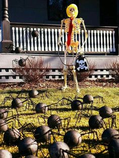 Yard spiders! Foam balls, pipe cleaner & secure to the ground with wire floral stakes