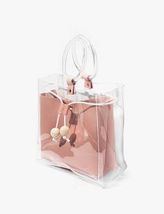 Cute transparent bag with clear ring handle and pink patent inner pouch . vinyl with faux leather Measures by mini bag Wood tassel beads Drawstring Clear Handbags, Purses And Handbags, Leather Handbags, Transparent Bag, Clear Bags, Girls Bags, Cute Bags, Lv Bags, Fashion Bags