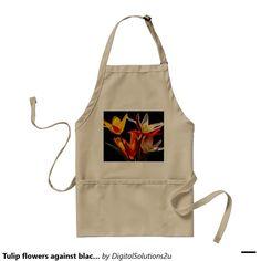 Tulip flowers against black background adult apron