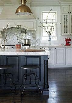 white kitchen, black island, brass pendant