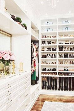 A perfectly-organized, designer-filled walk-in closet: the universal object of desire for every fashionable woman. While you may not have the real estate yet, there's no harm in taking wardrobe organization inspiration from these 14 enviable walk-ins.