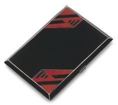 ETUI A CIGARETTES ART DECO en vermeil, de forme rectangulaire, à décor géométrique émaillé noir et rouge.  Vers 1925.  Poinçon de maître.  Dimensions : 7,8 x 11,4 x 0,9 cm environ.  Poids brut : 168,3