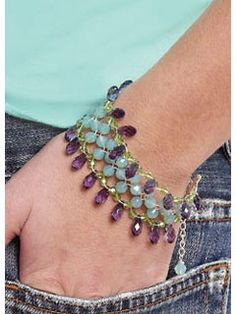 Bejeweled Crystal Bracelet. A lacy bracelet that is a good introduction for bead weaving. Bigger beads make bead weaving easy and the silver beading wire adds metallic shine for this bejeweled right-angle weave bracelet.
