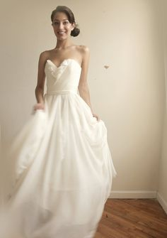 Again, not so into the whole wedding thing but wow, this dress is pretty...