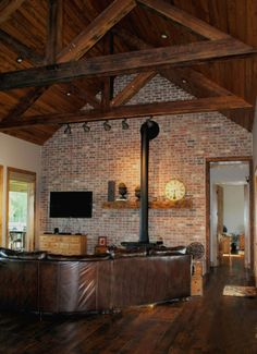 Cypress Beams/Truss with Tongue and Groove Cathedral Ceiling to Accent Brick Wall and Owner's Inherited Wood Stove. Knotty Pine Living Room, Knotty Pine Rooms, Knotty Pine Paneling, Vaulted Ceiling Lighting, Barn Lighting, Minimalist House Design, Minimalist Home, Brick Fireplace, Brick Wall