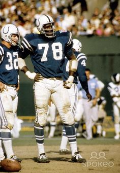 Bubba Smith (78) of the Baltimore Colts, standing next to linebacker Mike Curtis (32)